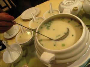 A claybpot of milky fish soup
