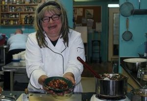 Chef Karen Barnaby cooking at Sustenance Festival